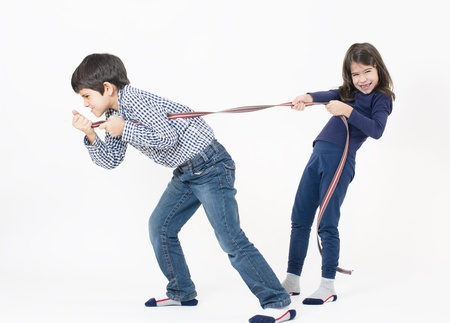 dragging: A boy and a girl playing isolated on white