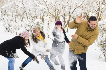 fight: A group of young people playing in the snow
