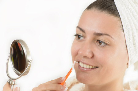 toothpick: Young woman using an interdental brush