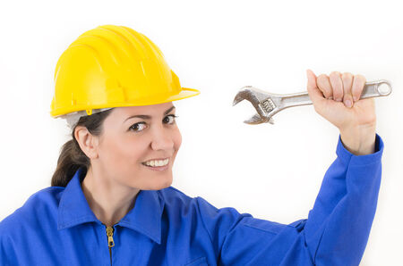Woman wearing protective equipment holding adjustable wrench photo