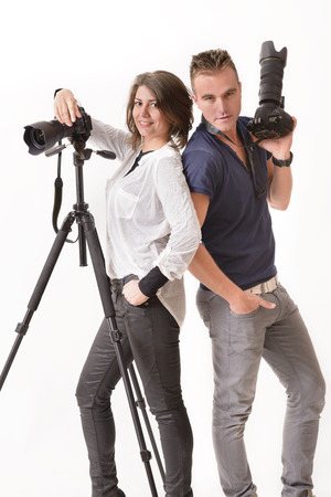 studio shoot: Professional photographer taking shoots with a telephoto lens Stock Photo