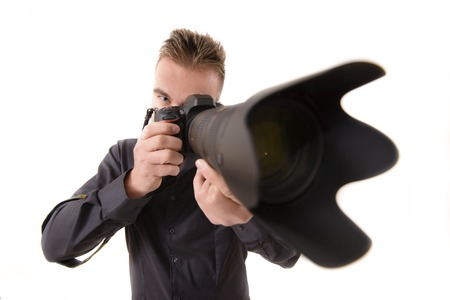 studio shoot: Professional Photographer taking Shot with a Telephone Lens