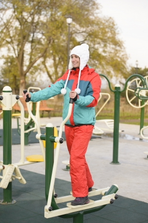 Young woman doing outdoor exercises in a park