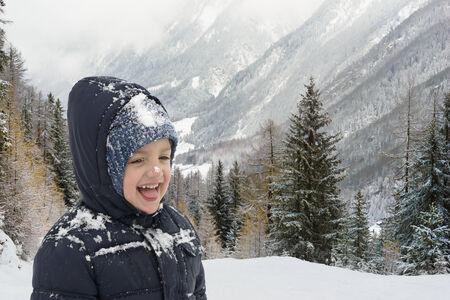 Happy child in wintertime in mountain resort photo