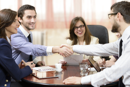 sales meeting: Business group sealing a deal at office Stock Photo