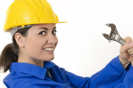 entertainment risk: Woman wearing protective equipment holding adjustable wrench