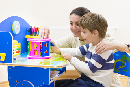 for children toys: Mother playing with her child some creativity game