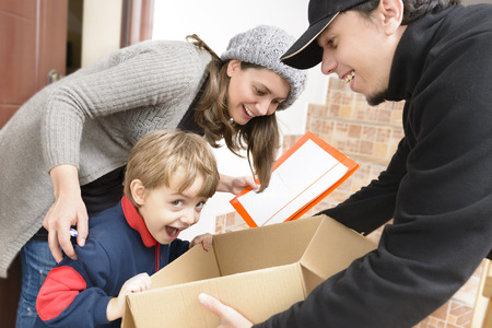 Courier man Delivering a Package to a happy boy