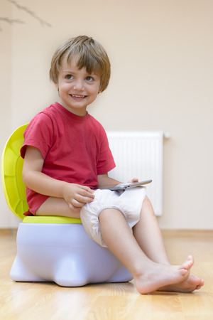 potty: Boy on potty using tablet pc