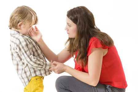 child protection: Mother consoling her little boy Stock Photo