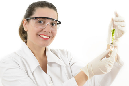 biologist: Young Woman working with plants in a lab