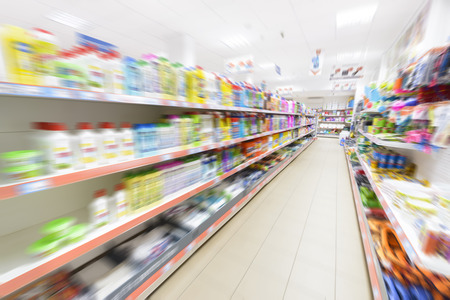 Products in row in a supermarket, motion blur.