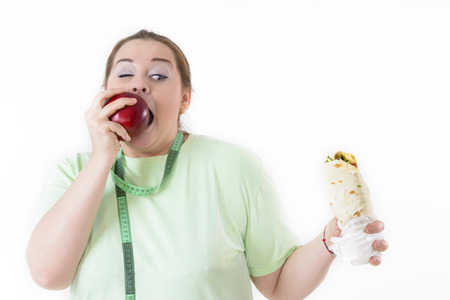 dietology: Corpulent woman struggle to eat healthy. Choosing healthy food.