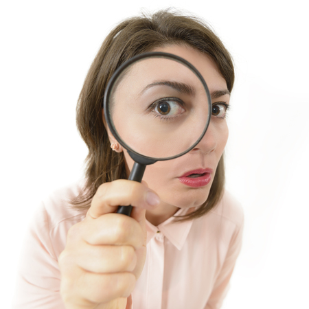 price cut: Price Cut Hunting, woman looking through an eyeglass Stock Photo
