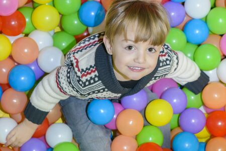 playcentre: Happy Kid Playing with balls at kindergarten