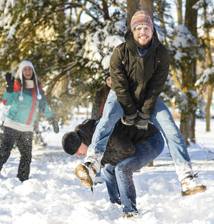 people in action: Jumping over another person (Goat) winter time