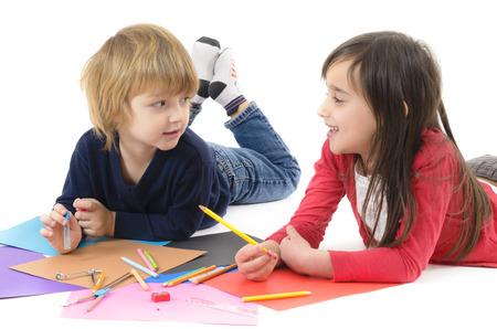 kid book: Two happy children doing homework isolated on white Stock Photo