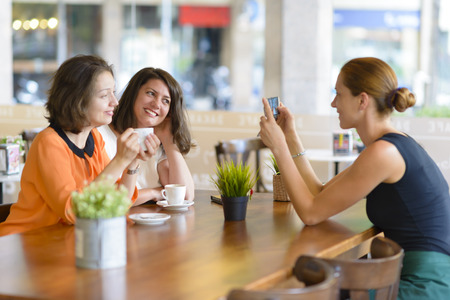 Waitress takes pictures for two customer