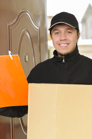 courier: Courier Delivering a Package to entrance