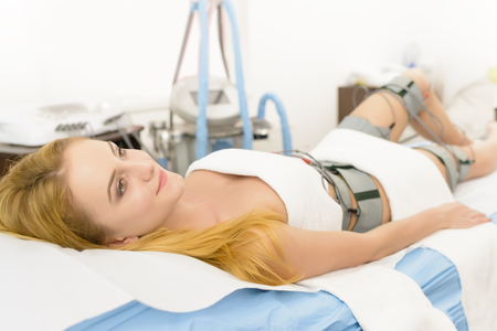 electronically: Beautiful woman getting electrostimulation therapy at beauty salon