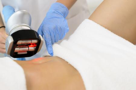 Beautiful woman getting cavitation treatment at beauty salon Imagens