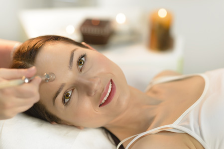 Beautiful woman getting microdermabrasion at beauty salon