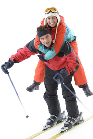 Young sportive couple, beautful woman in the back of handsom man, equiped for ski Reklamní fotografie