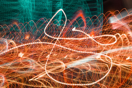 shutter speed: Neon blurry at motion Abstract multicolored blurred lights background swirl trail effect . slow shutter speed effect . Stock Photo