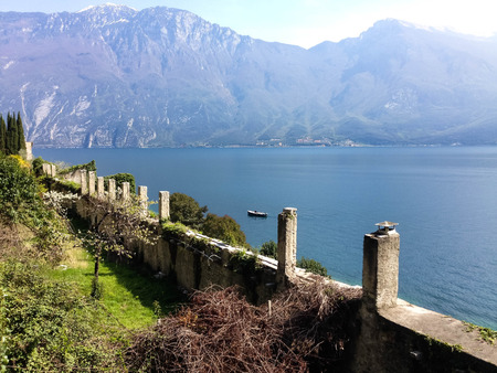 Remains of an old stone wall on the shore of lake Garda