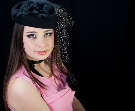 beautifull brunette , shooting in the studio with dark background  photo