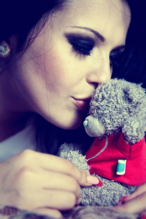 beautyfull brunette kissing the teddybear Banco de Imagens