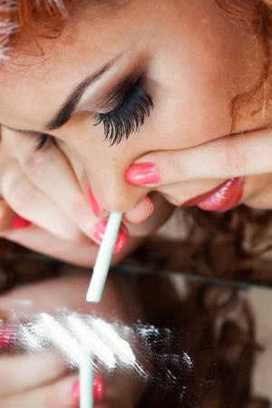a closeup portrait of a girl using drugs photo