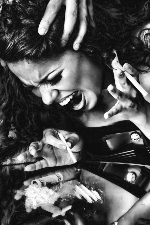 drug overdose: a closeup portrait of a girl using drugs