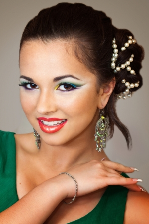 pretty brunette smiling and having an oriental makeup  photo