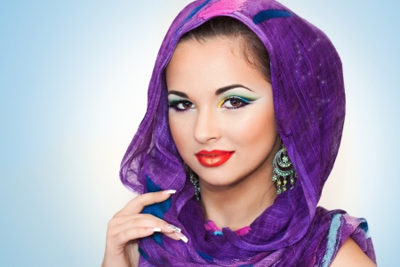 pretty brunette smiling and having an oriental makeup  Imagens