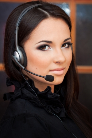 hotline: beautiful girl with a headset looking at the camera  Stock Photo