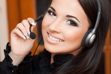 beautiful girl with a headset looking at the camera  Фото со стока