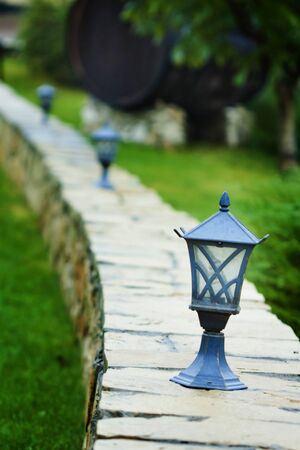 a close up picture of a lantern on the wall photo