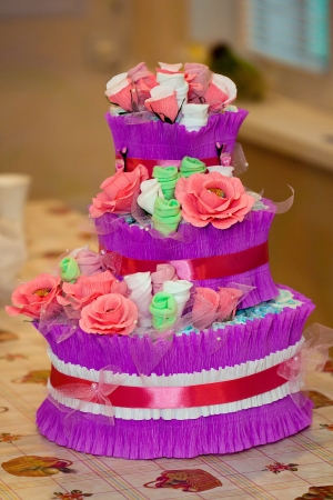 Decorative Cake made of flowers and new babe born's accessories Stock Photo - 16235400