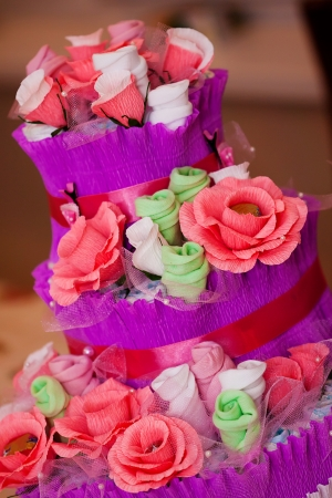 Decorative Cake made of flowers and new babe born's accessories Stock Photo - 16235394