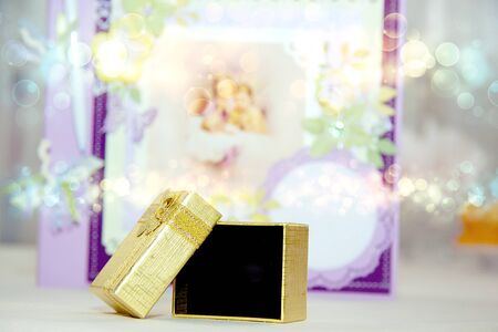 A close up of a gold gift box photo