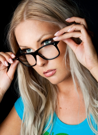 girl with gray eyes: Blonde girl wearing glasses and looking aside