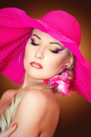 pink hat: Portraite of a blonde girl with a pink hat
