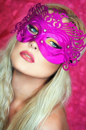A close up portrait of a blonde with a pink mask  photo