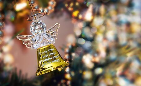 Golen Angel Bell on a Christmas Tree photo