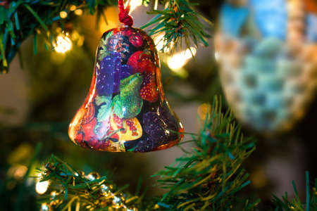 Christmas Bell ornamented with fruits on a Christmas Tree photo
