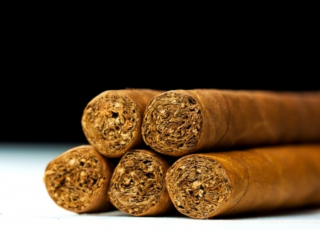 Close up picture of five cigars in the studio photo