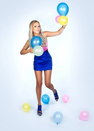 Girl looking happy holding few balloons  photo