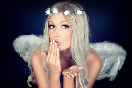 Portrait of a blonde in white Angel costume  photo