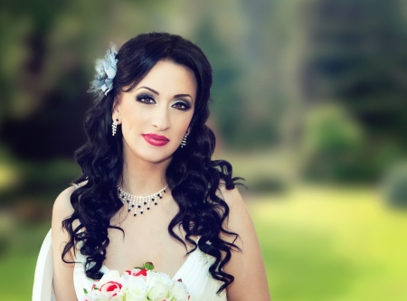 close up of a beautiful bride in the park